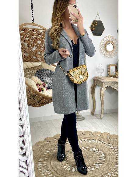 Mon superbe manteau gris